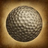 foto of dimples  - Golf ball in an old vintage grunge texture on parchement paper as a traditional sporting symbol of an individual leisure game played on an eighteen hole course - JPG