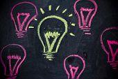 Funny Lightbulb On Blackboard, Concept Of Uniqueness
