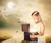 Blonde Girl Opening A Treasure Box