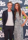 LOS ANGELES - JUN 05:  TOM FELTON & DATE arriving to MTV Movie Awards 2011  on June 05, 2011 in Hollywood, CA