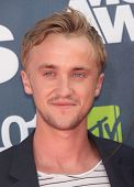 LOS ANGELES - JUN 05:  TOM FELTON arriving to MTV Movie Awards 2011  on June 05, 2011 in Hollywood, CA