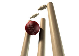 picture of cricket shots  - A red leather cricket ball striking and unsettling wooden cricket wickets and bails on an isolated background - JPG