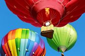 stock photo of air transport  - colorful hot air balloons over blue sky - JPG