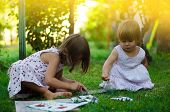 Girls having fun painting in the garden, together concept, family or friendship concept