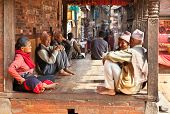 BHAKTAPUR - MAY 20 : Unidentified Tharu old people besides the street of Bhaktapur, Nepal on May 20,