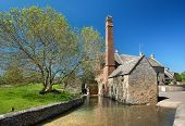 stock photo of slaughter  - The old Cotswold mill at Lower Slaughter - JPG