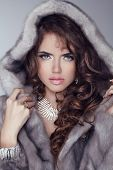 Beauty Fashion Model Woman In Mink Fur Coat. Winter Girl In Luxury Clothes And Long Wavy Hair. Model