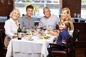 Portrait of a happy smiling family in a restaurant
