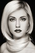 Duotone portrait of young beautiful blond woman with stylish make-up