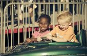 picture of carnival ride  - Kids on an amusement park ride - JPG