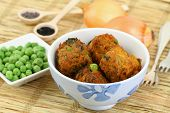 Indian pakora snacks in bowl, close up