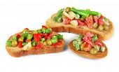 Sandwiches with vegetables and greens isolated on white