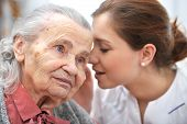 image of hospice  - Female nurse is speaking in senior woman ear - JPG