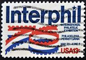 A stamp shows image of the dedicated to the Interphil - Iternational Philatelic Exhibition