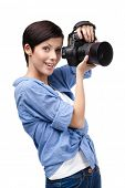 Lady takes photos holding photographic camera, isolated on white