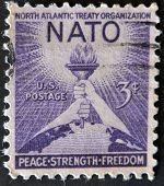 A stamp printed in the USA shows North Atlantic Treaty Organization (NATO) Peace Strenght Freedom