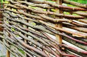 Wattle fence of wooden rods
