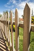 stock photo of stockade  - close up of a wooden fence in sunny day