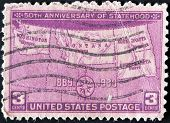 A stamp printed in USA shows map of states with inscription
