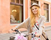 summer holidays, bikes, travel concept - attractive woman with bicycle in the city