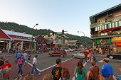 Tourists And Traffic At Stoplight 8 On The Main Road Through Gatlinburg, Tennessee