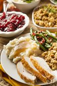 stock photo of mashed potatoes  - Homemade Turkey Thanksgiving Dinner with Mashed Potatoes Stuffing and Corn - JPG