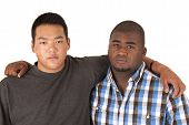 African American Asian Brothers With Arms Around Each Other