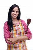 Young Indian Woman Holding Kitchen Utensil Against White