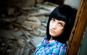 Girl in a destroyed building