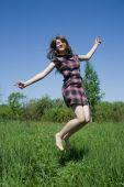 Jumping Teen Girl Against Blue Sky