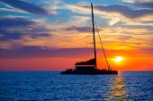 Ibiza san Antonio Abad de Portmany catamaran sailboat sunset with in Balearic islands of spain