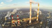 Power plant with many different chimneys at  sunnywinter day. Aerial view
