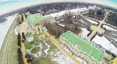 Temple and buildings in museum-estate Kuskovo at winter, Moscow, Russia. Aerial view