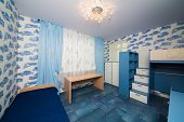 Beautiful modern children bedroom with fun wallpapers.