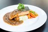 grilled salmon steak with pepper sauce