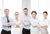 business concept - picture of happy business team in office
