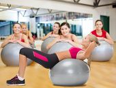 fitness, healcare and dieting concept - young woman doing exercise on fitness ball