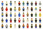 A group of fifty various lego mini figures of the past and present on white background.