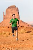 Trail running man. Male runner in Monument Valley sprinting fast training for success. Fit sports fi