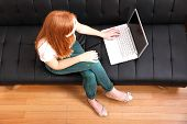 Young Redhead Girl With A Laptop