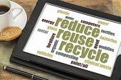 reduce, reuse, recycle word cloud on a digital tablet with a cup of coffee