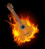 Acoustic guitar in fire flame