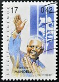 BELGIUM - CIRCA 1999: A stamp printed in Belgium showing an image of Nelson Mandela circa 1999.
