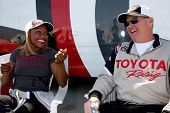LOS ANGELES - MAR 15:  Carmelita Jeter, Al Unser Jr at the Toyota Grand Prix of Long Beach Pro-Celeb