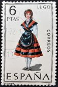 A stamp printed in Spain dedicated to Provincial Costumes shows a woman from Lugo