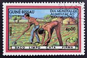 stamp commemorative the world food day showing farmers plowing the land