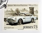 Stamp printed in Jersey dedicated to classic cars shows Aston Martin DB5