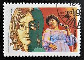 stamp printed in Madagascar shows John Lennon (1940-1980) Ella Fitzgerald (1917-1996)