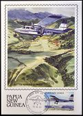stamp shows A british norman islander in flight over the Northern Province of Papua New Guinea