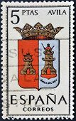 A stamp printed in Spain dedicated to Arms of Provincial Capitals shows Avila